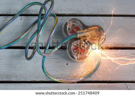 Short Circuit on Extension Cord Economy Concept - stock photo