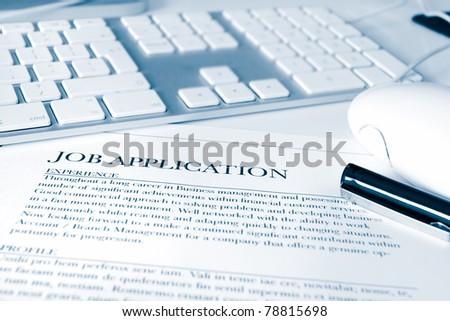 short depth of field focus on a job application - stock photo