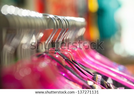 Short focus picture of hanger for clothes. Hanging in a row. - stock photo