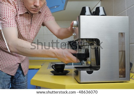 Short hair man making espresso on the kitchen.