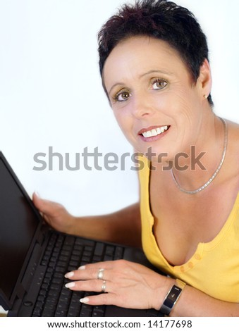Short hair mature woman working with laptop