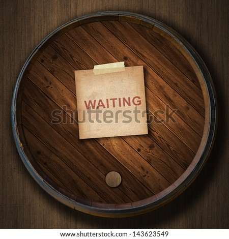 short note old paper and text waiting on the Wine barrels wood background - stock photo
