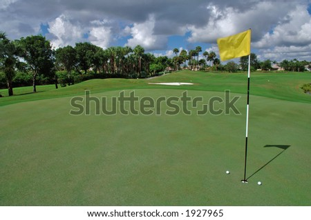 short putts on the green - stock photo