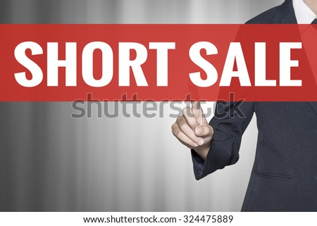 Short Sale word on virtual screen push by business woman red tab - stock photo