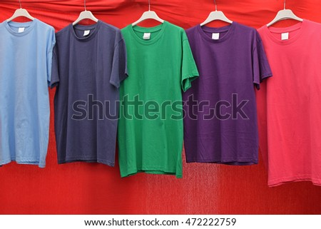Short sleeve cotton t-shirts in various colors for sale at street market.