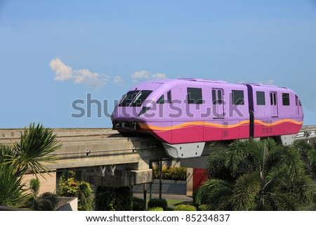 Short violet monorail train from funny land. - stock photo