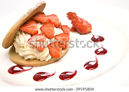 Shortbread biscuit filled with cream and strawberries - stock photo