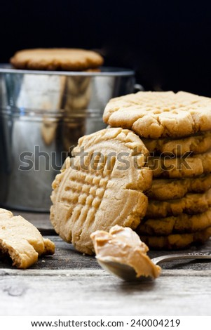 shortbread cookie with peanut butter on a black background - stock photo