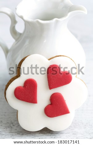 Shortbread cookies in the shape of heart decorated with sugar paste