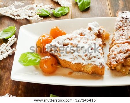 Shortcrust apple pie with cinnamon and basil . Shallow dof. - stock photo