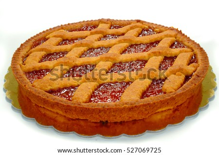 shortcrust cake covered with apricot jam