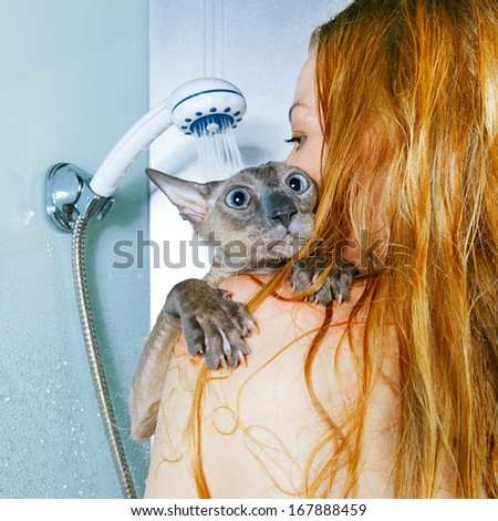 shorthair oriental cat and girl, taking a shower