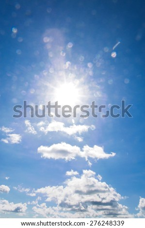 Shot against the bright sun with blue sky white cloud - stock photo