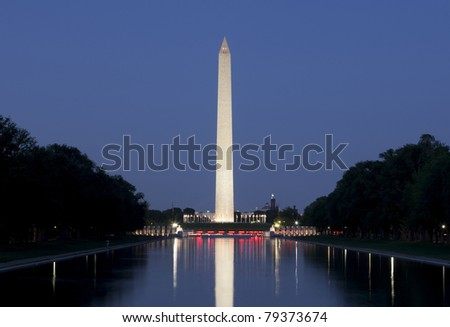 Shot at dusk with lights reflecting in pool. - stock photo