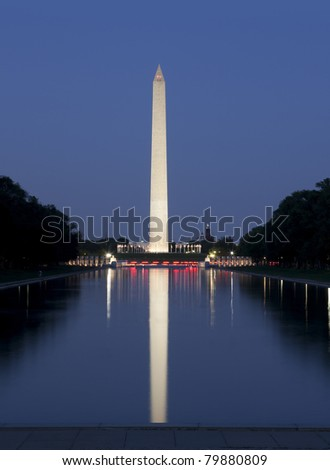 Shot at dusk with lights reflecting in pool.