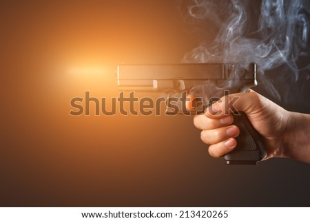 shot from a handgun with fire and smoke - stock photo