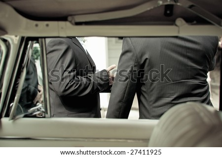 Shot from interior of vintage car of grrom and best man at a wedding