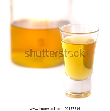 shot glass and bottle - stock photo