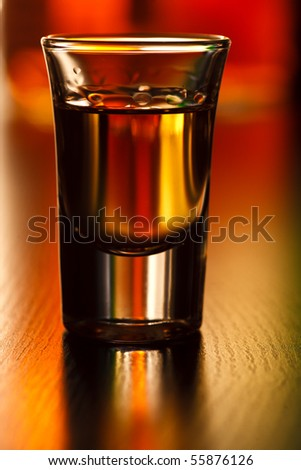 Shot glass on a table, shallow focus - stock photo