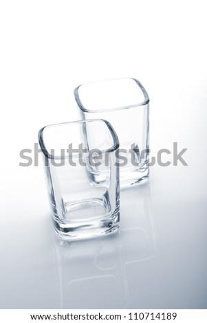 Shot glasses. Blue toned - stock photo