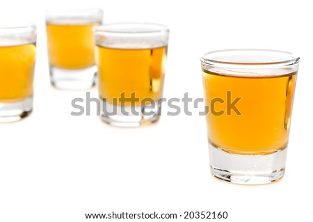 Shot glasses of whiskey