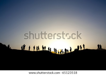 Shot in the province of Sinai in northern egypt, tourists are silhouetted against the dusk - stock photo