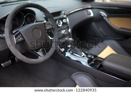 Shot inside a vehicle with a leather interior - stock photo