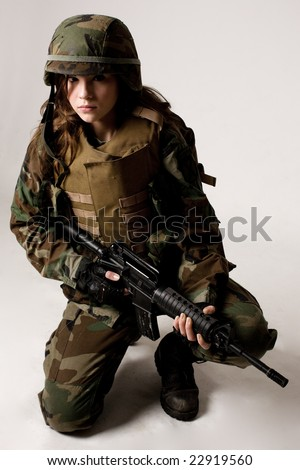 Shot of a beautiful army girl. Uniform conforms to special services(soldiers) of the NATO countries. Shot in studio. Isolated on white.
