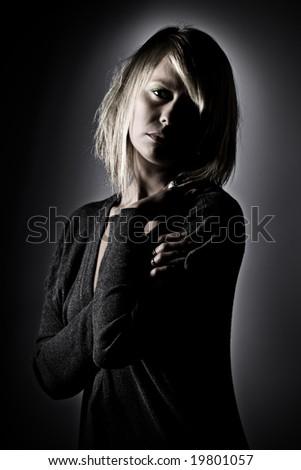 Shot of a Beautiful Blonde Girl Looking at Camera - stock photo