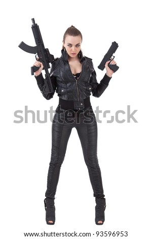 Shot of a beautiful girl posing with a guns - stock photo