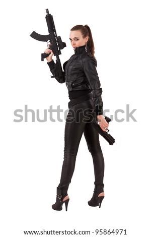 Shot of a beautiful woman posing with a guns - stock photo