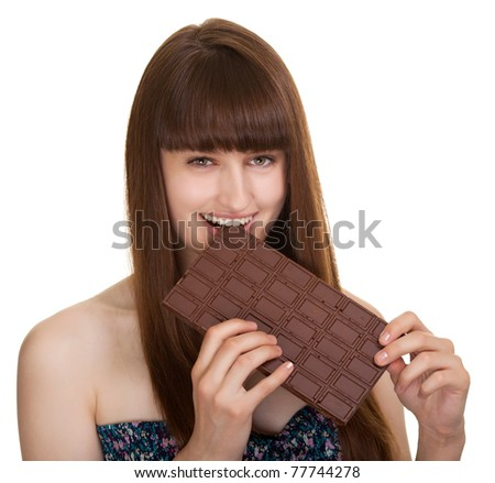 Shot of a beautiful young woman holding big chocolate bar