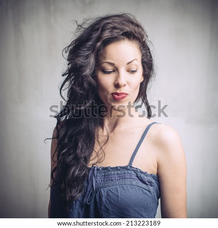 Shot of a beautiful young woman with pursed lips - stock photo