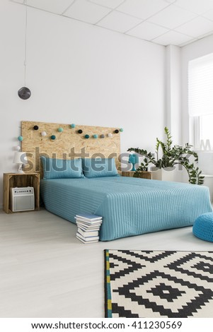Shot of a bed in a modern spacious bedroom