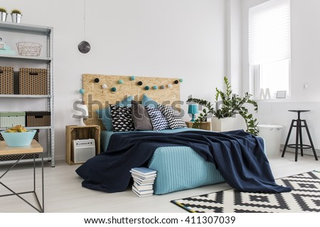 Shot of a bed in a spacious modern bedroom - stock photo