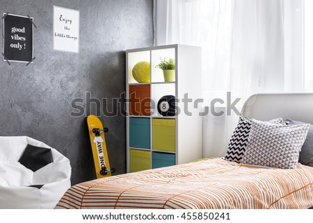 Shot Of A Bedroom Interior With A Single Bed And Colorful Shelf Part 96