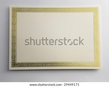 shot of a blank certificate on the plain background - stock photo