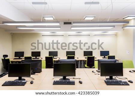 Shot of a bright room with several computers
