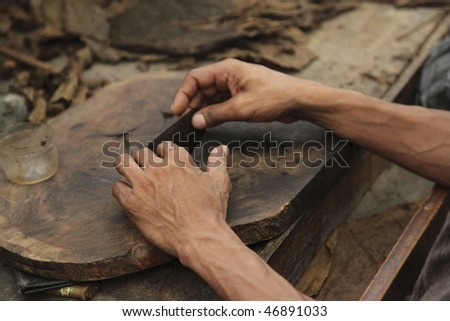 Shot of a Cigar Maker in Dominican Republic - stock photo