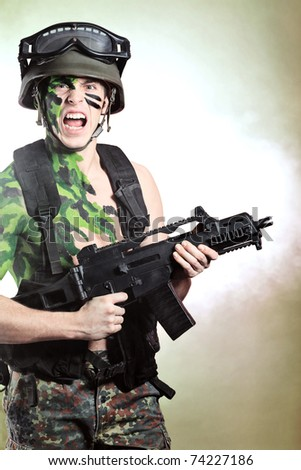 Shot of a conceptual soldier painted in khaki colors. Studio shot. - stock photo