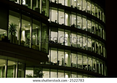 Shot of a corporate office building in the night. - stock photo