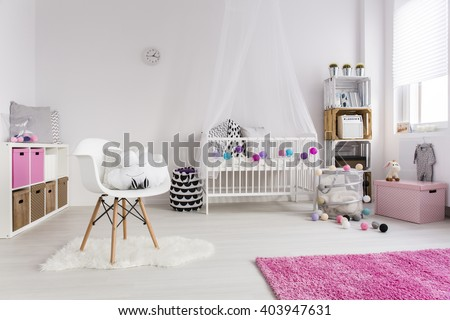 Shot of a cosy nursery room for a girl - stock photo