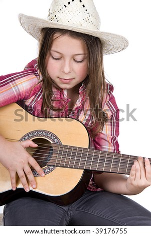 Shot of a Cute Girl Playing the Guitar - stock photo
