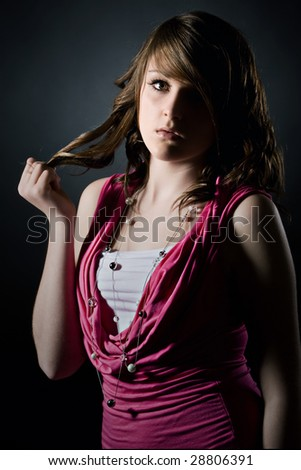 Shot of a Cute Teenager Playing with her Hair