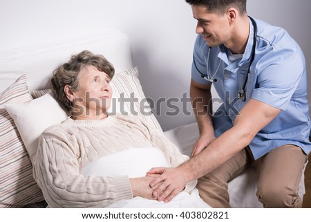 Shot of a doctor visiting his patient at home