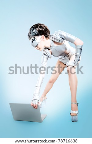 Shot of a futuristic young woman with a laptop.