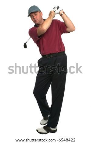 Shot of a golfer's follow through swing after an wood shot. - stock photo