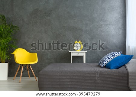 Shot of a grey bedroom decorated with colorful details - stock photo