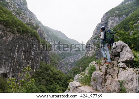 Shot of a handsome young man enjoying the view while hiking - stock photo