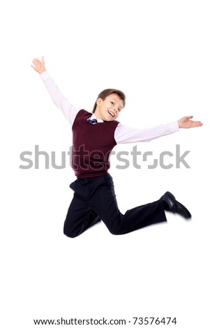 Shot of a happy jumping boy. Isolated over white background. - stock photo